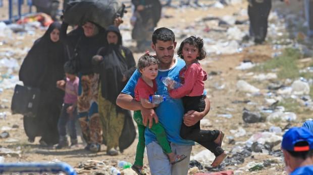 Rifugiati siriani al confine con la Turchia