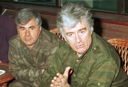** FILE ** In this May 1994 file photo, Bosnian Serb Stojan Zupljanin, left, and Radovan Karadzic speak in the Bosnian town of Banja Luka, 120 kilometers (75 miles) northwest of the Bosnian capital of Sarajevo. Karadzic, accused architect of massacres making him one of the world's top war crimes fugitives, was arrested on Monday evening, July 21, 2008 in a sweep by Serbian security forces, the country's president and the U.N. tribunal said. Serb authorities turned Zupljanin over to The Hague in June 2008 after nine years on the run. (AP Photo/Radivoje Pavicic)